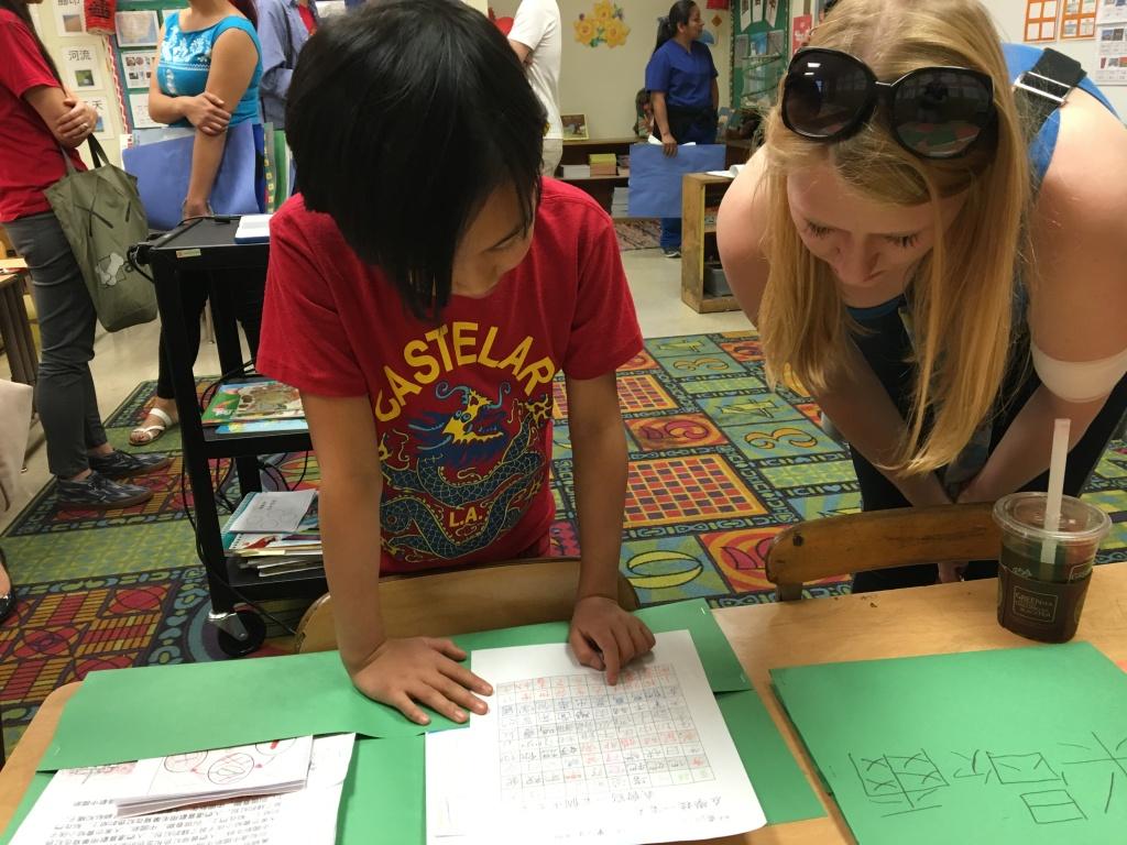 Eloise Wong, a second grader in Castelar Street Elementary's Mandarin dual language program, shows off her classwork during an open house.