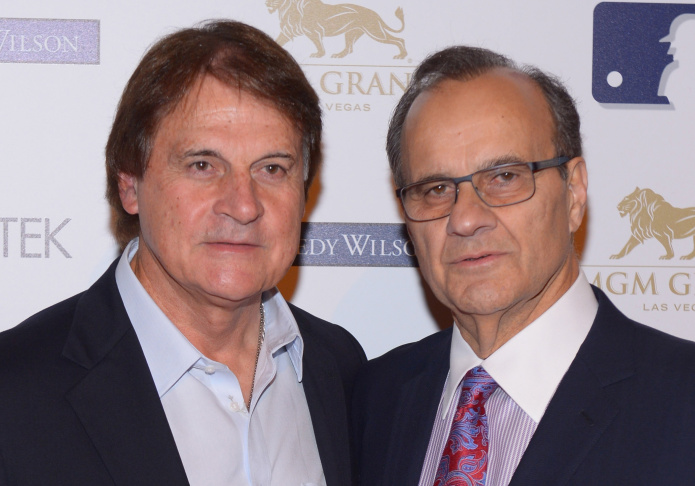 Former Major League Baseball manager and player Tony La Russa (L) and Major League Baseball Executive Vice President of Baseball operations and former Major League Baseball manager Joe Torre arrive at Tony La Russa's 2nd annual Leaders & Legends gala benefitting Animal Rescue Foundation at the MGM Grand Hotel/Casino on November 22, 2013 in Las Vegas, Nevada.