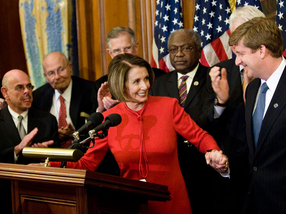 Speaker of the House Nancy Pelosi grabs hold of Rep. Patrick Kennedy's hand during a press conference following House passage of the Democrats' health care bill on Nov. 7.