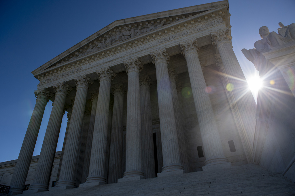 The U.S. Supreme Court seen with the sun shining behind it last month.