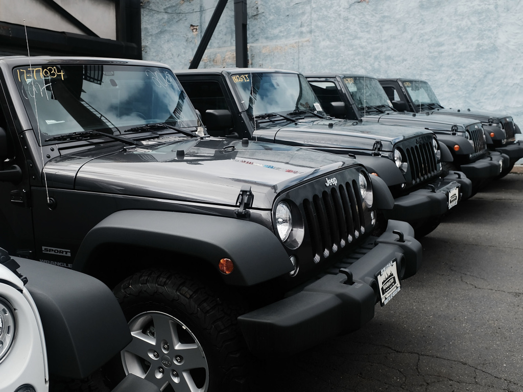 Jeep Wranglers are displayed at a Manhattan Fiat Chrysler dealership. The automaker's latest quarterly earnings announcement comes at a time of deep uncertainty for the company.