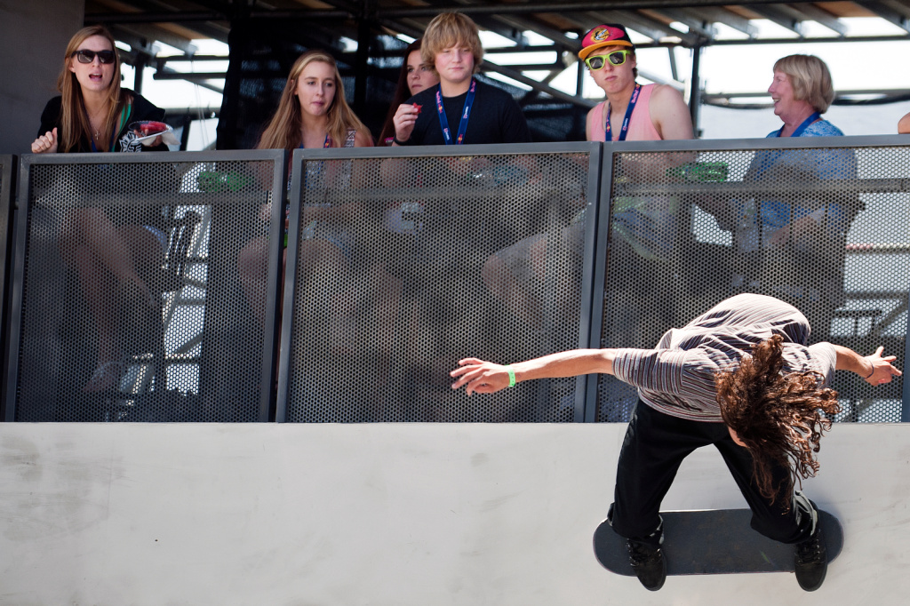 Attendees watch as skateboarder Evan Smith attempts a trick during the final round of the Men's Street league Skateboarding competition during the first day of X Games.