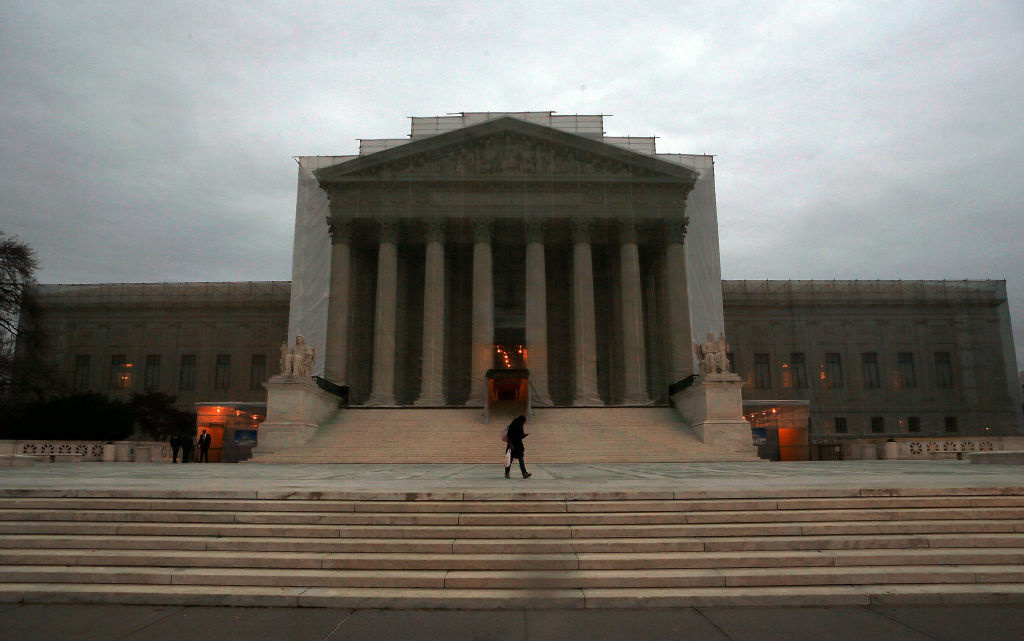 The U.S. Supreme Court building is draped in a photo-realistic sheet during a repair and preservation project December 7, 2012, 2012 in Washington, DC.