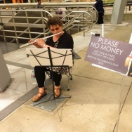 Diana Irving plays flute on Bach in the Subways Day in Los Angeles in 2014.