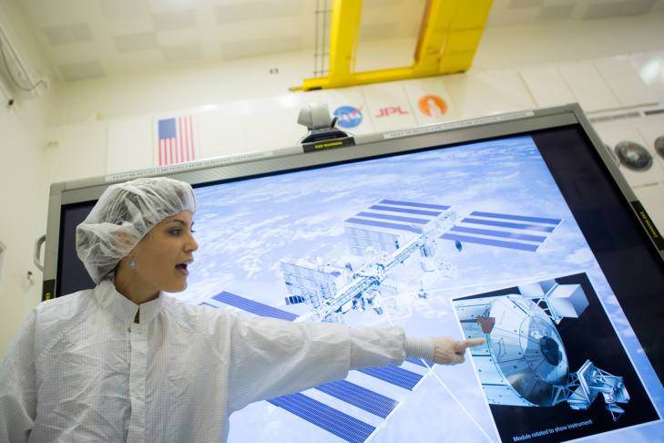 NASA administrator Charles Bolden receives a briefing on the mount for the RapidScat system that will be attached to the International Space Station.