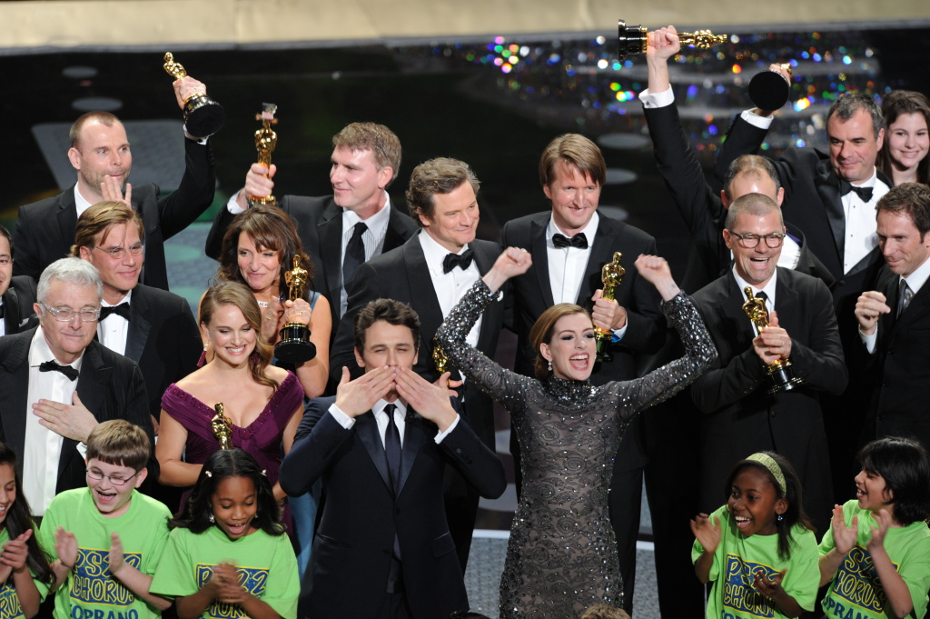 Presenters Anne Hathaway (C, R) and James Franco (C, L) and winners celebrate at the end of the 83rd annual Academy Awards at the Kodak Theater in Hollywood on February 27, 2011.