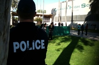 A police officer outside Gardena High School on Jan. 18, 2011.