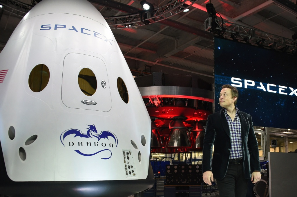 SpaceX CEO Elon Musk introduces SpaceX's Dragon V2 spacecraft, the company's next generation version of the Dragon ship designed to carry astronauts into space, at a press conference in Hawthorne, California on May 29, 2014.