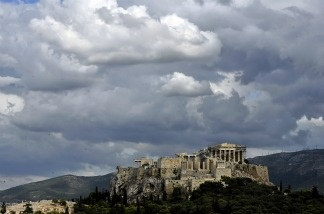 Clouds gather over the Acropolis hill in Athens on September 21, 2011.