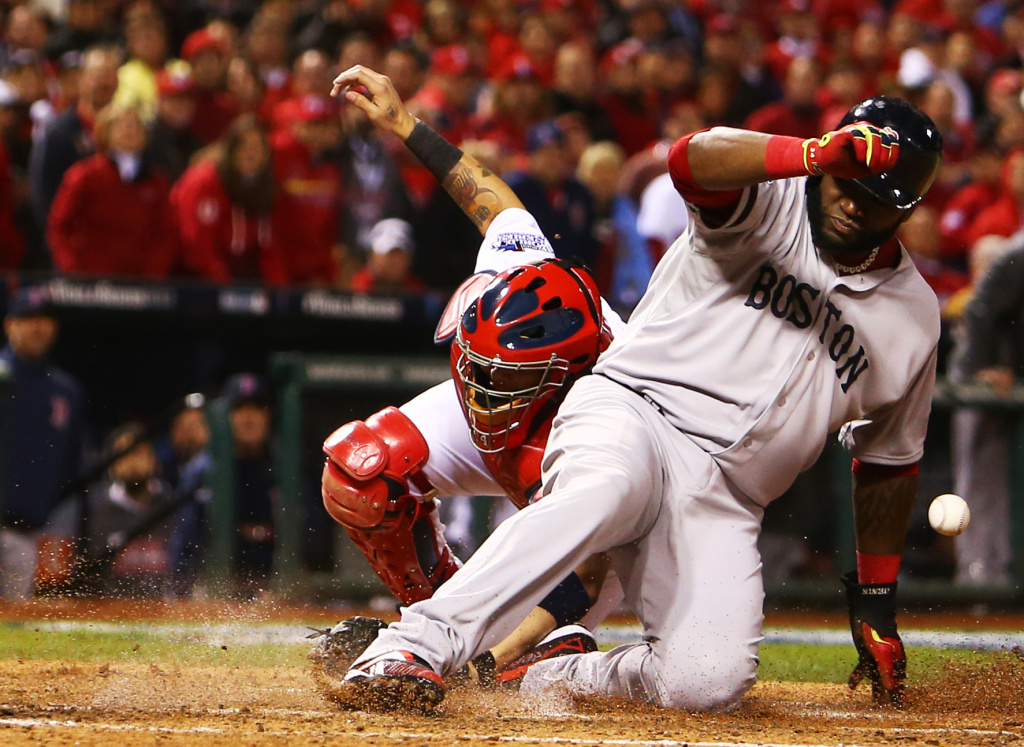 David Ortiz #34 of the Boston Red Sox slides safe into home plate on a sacrifice fly to left field hit by teammate Stephen Drew #7 against Lance Lynn #31 of the St. Louis Cardinals in the fifth inning during Game Four of the 2013 World Series at Busch Stadium on October 27, 2013 in St Louis, Missouri.