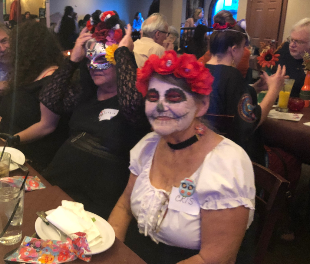 "Participants at L.A.'s first ""Secular Day of the Dead"" celebrate in Koreatown on Nov. 1, 2018."