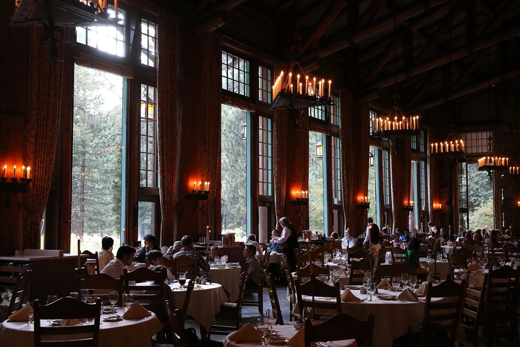 Park visitors sit for dinner at the Ahwahnee Hotel Dining Room in Yosemite National Park. Aramark has been selected to take over hotels, restaurants and outdoor activities at Yosemite National Park.