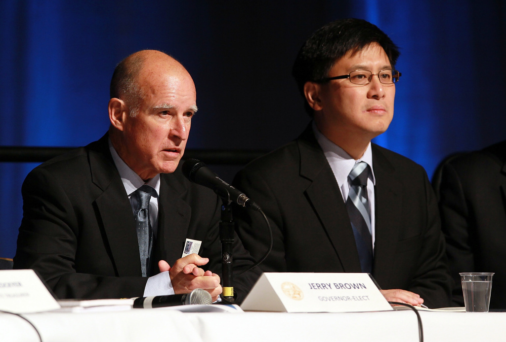 California state controller John Chiang (D) looks on as California governor-elect Jerry Brown speaks during a briefing on California's state budget on December 8, 2010 in Sacramento, California.