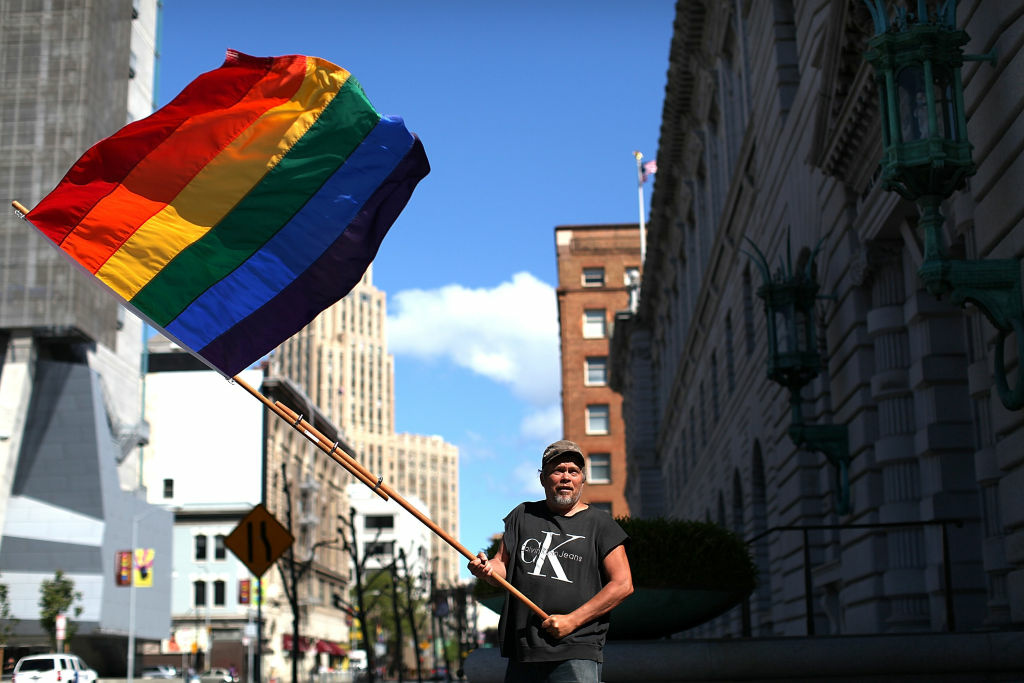 Bob Sodervick waves a gay pride flag outside of the Ninth U.S. Circuit Court of Appeals in San Francisco, California.