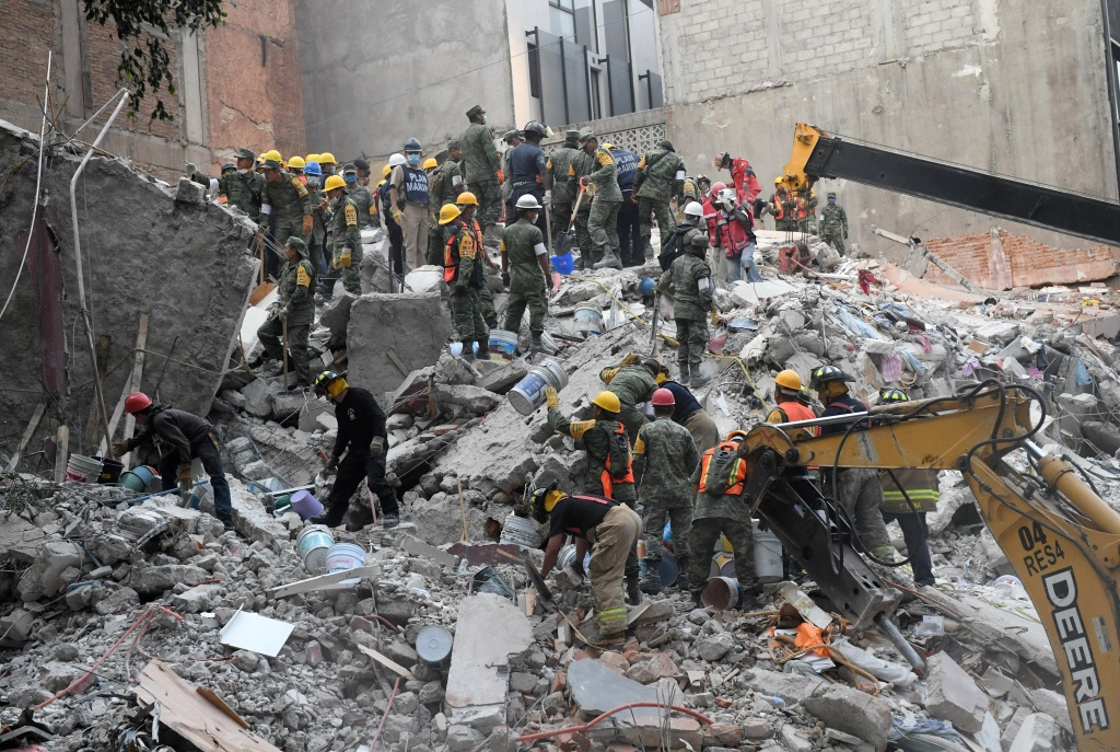 Volunteers remove rubble during the search for survivors in a flattened building in Mexico City on September 20, 2017 after a strong quake hit central Mexico on the eve killing at least 240 people.  (PEDRO PARDO/AFP/Getty Images)