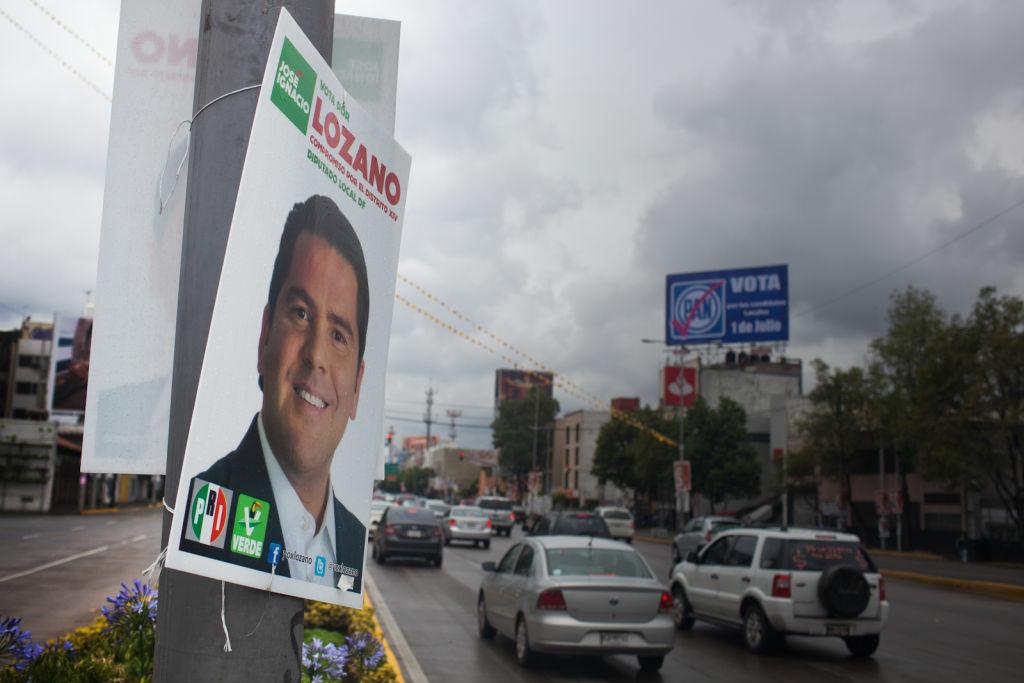 Campaign signs line Avenida de los Insurgentes in central Mexico City.