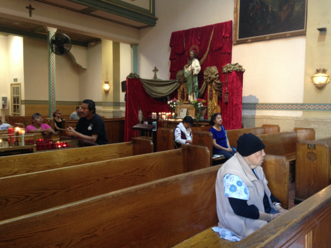 Churchgoers in the chapel at Our Lady Queen of Angels Church in downtown Los Angeles attend a Spanish-language Mass on Wednesday.