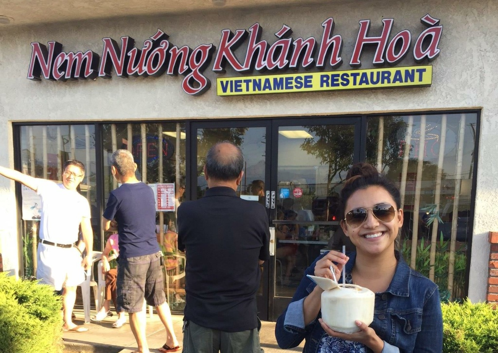 KPCC listener Chelsea Alcantara stands in front of her local – and favorite – pho restaurant