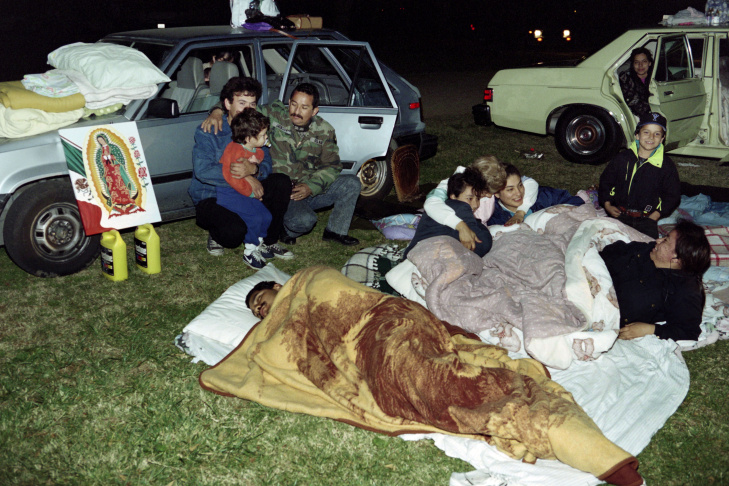 The Lopez and Garcia families camp out i