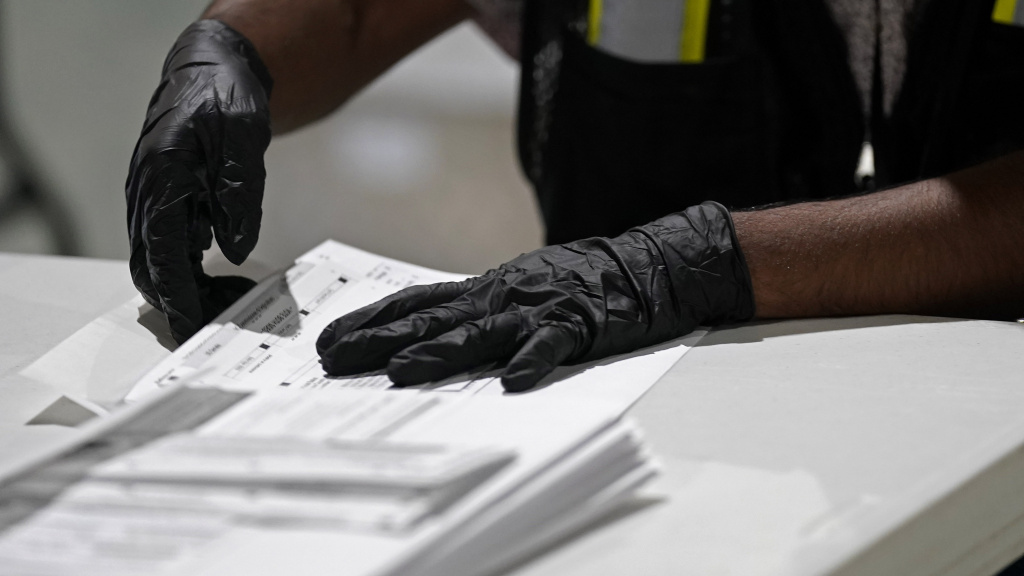A workers prepares absentee ballots for mailing at the Wake County Board of Elections in Raleigh, N.C., earlier this month.