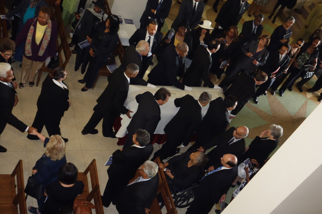Pallbearers escort the casket of former California Lt. Gov. Mervyn Dymally at his funeral at Holy Cross Mortuary, Oct. 17, 2012.