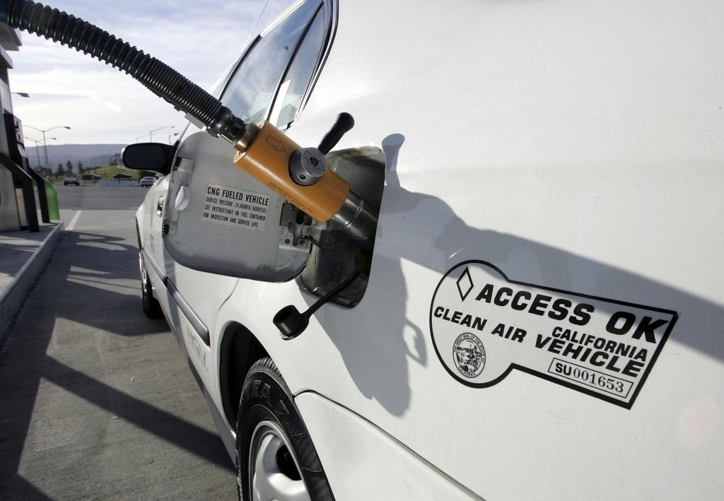 A compressed natural gas (CNG) hose dispenses gas to a Honda Civic at a clean energy fuel station January 18, 2007 in San Francisco, California. California governor Arnold Schwarzenegger signed executive order S-01-07 establishing the world's first low carbon standard for transportation fuels in the state of California. The order will reduce dependence on oil and will lower carbon intensity of California's passenger vehicle fuels by at least 10 percent by 2020.