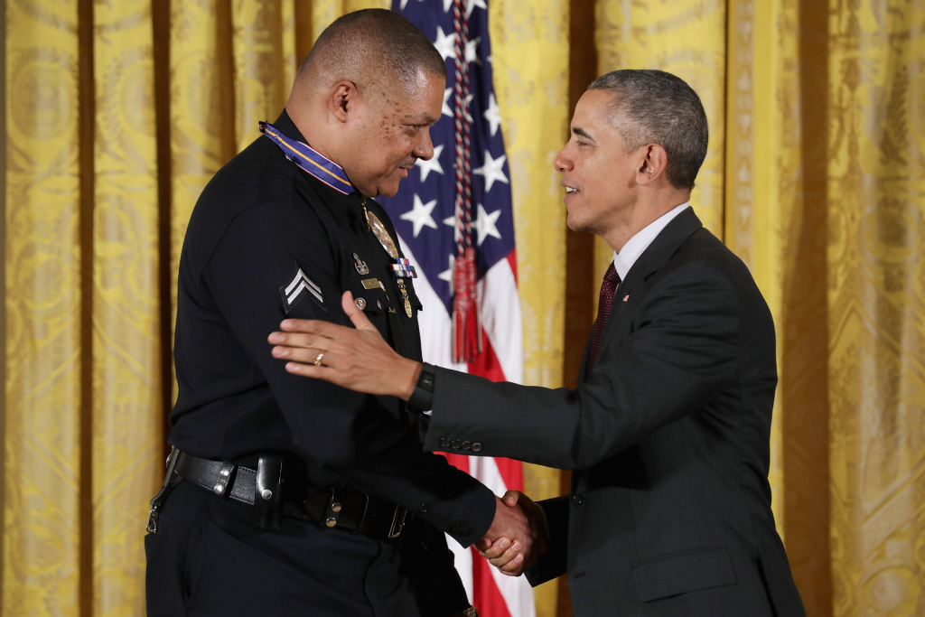 U.S. President Barack Obama awards Los Angeles Police Department Officer Donald Thompson with the 2013-2014 Public Safety Office Medal of Valor during a ceremony in the East Room of the White House May 16, 2016 in Washington, DC. According to the White House, 'While off duty, Officer Thompson traversed two freeway dividers and endured first- and second-degree burns while pulling an unconscious man to safety from a car moments before it became engulfed in flames.