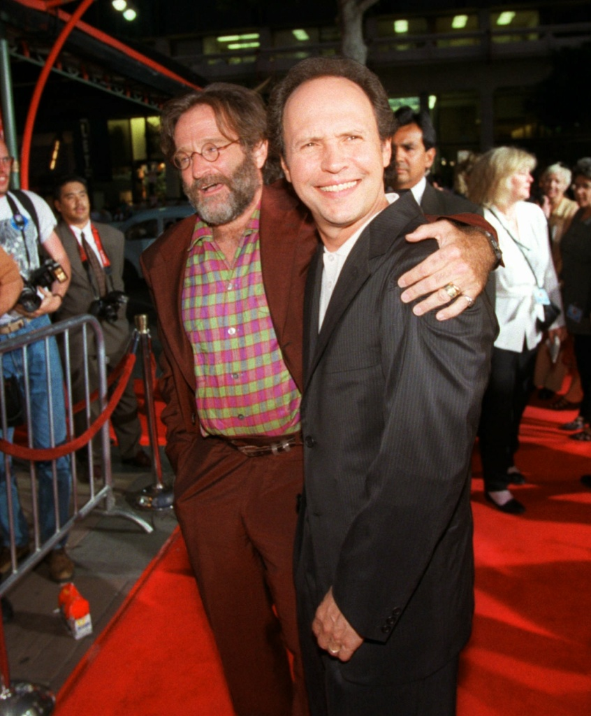 Actors Robin Williams, left, and Billy Crystal, right, joke around for photographers as they arrive at Mann's Chinese Theatre in the Hollywood area of Los Angeles for the premiere of