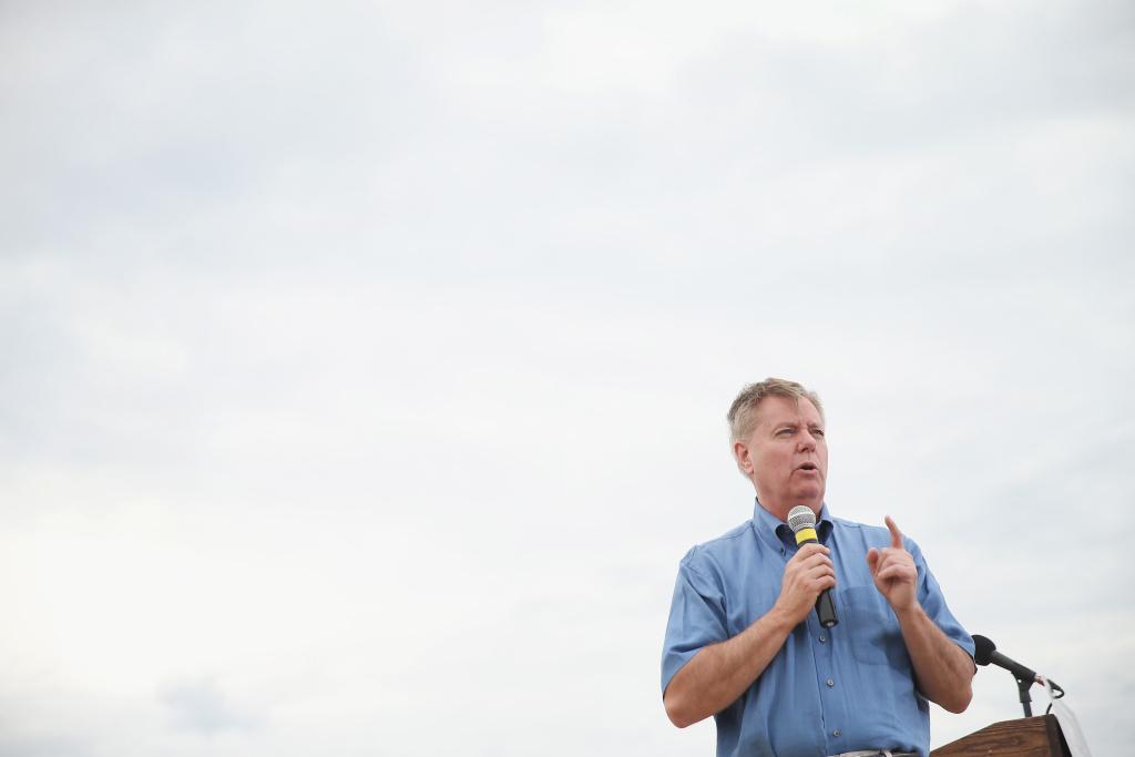 Republican presidential hopeful Senator Lindsey Graham (R-SC) speaks at a Roast and Ride event hosted by freshman Senator Joni Ernst (R-IA) on June 6, 2015 in Boone, Iowa.