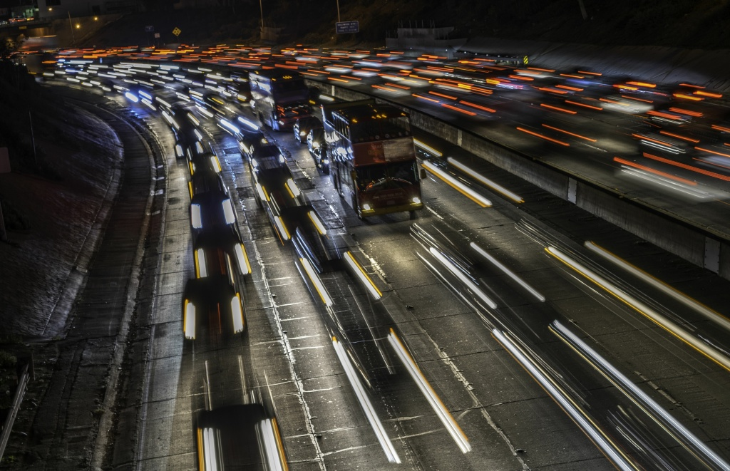 Cars and trucks are slowly moving during the evening's rush hour on Hollywood Freeway (Highway 101) in Los Angeles California on February 13, 2014.