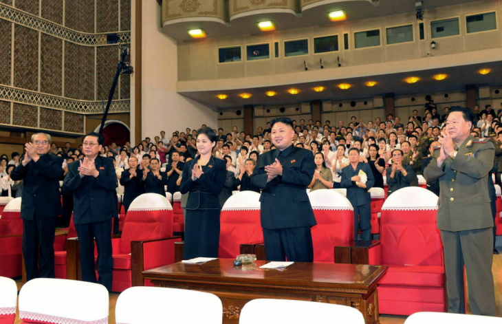 In this image made off North Korea's KRT video footage, North Korea's new Moranbong band and performers dressed as America's cartoon characters perform in Pyongyang, North Korea, Friday, July 6, 2012. Mickey Mouse and Winnie the Pooh took the stage for new leader Kim Jong Un, in an unusual performance featuring Disney characters in North Korea.
