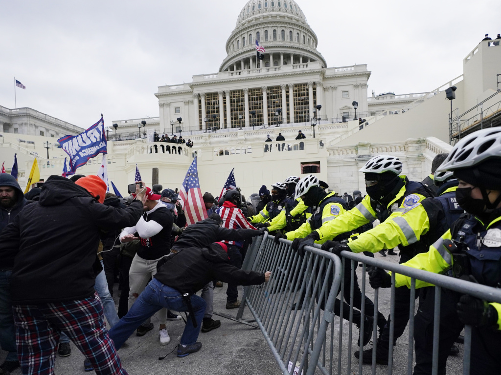 In this Jan. 6, 2021 file photo, rioters try to break through a police barrier at the Capitol in Washington.