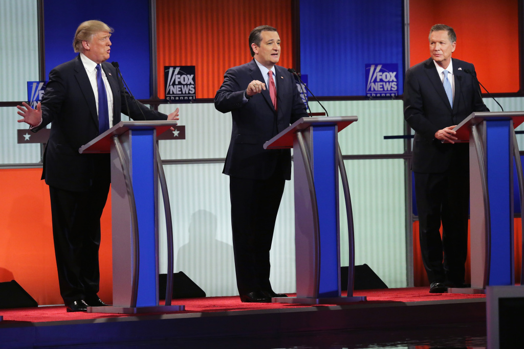 File: Republican presidential candidates (L to R) Donald Trump, Sen. Ted Cruz (R-TX), and Ohio Gov. John Kasich participate in a debate sponsored by Fox News at the Fox Theatre on March 3, 2016 in Detroit, Michigan.