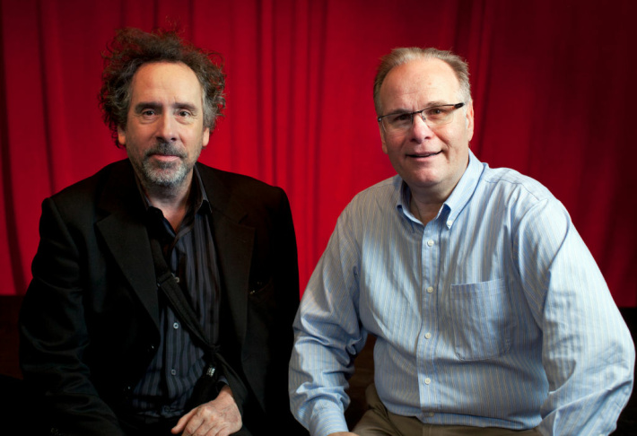 Writer and director Tim Burton and AirTalk host Larry Mantle pose for a portrait in the Crawford Family Forum.