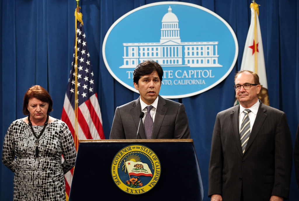 California Senate President pro Tempore Kevin de Leon speaks as Assembly Speaker Toni Atkins and Sen. Bob Huff look on during a news conference on March 19, 2015.