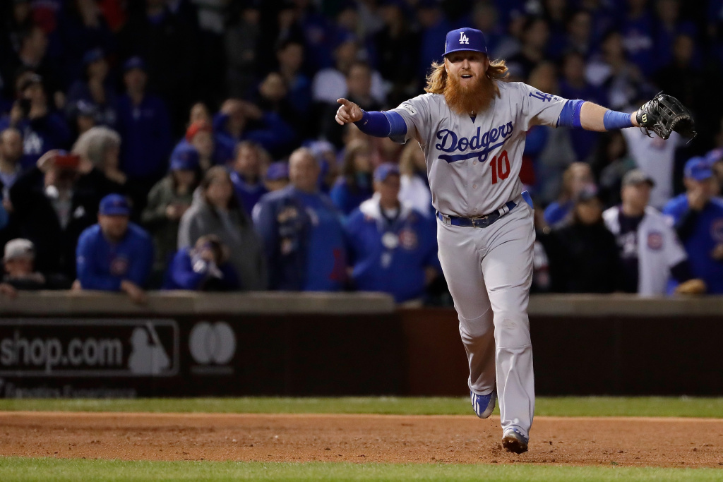 Justin Turner #10 of the Los Angeles Dodgers celebrates after beating the Chicago Cubs 11-1 in game five of the National League Championship Series at Wrigley Field on October 19, 2017 in Chicago, Illinois. The Dodgers advance to the 2017 World Series.