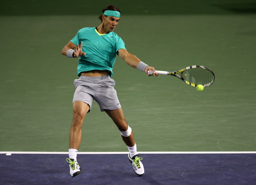 Rafael Nadal of Spain hits a return to Ryan Harrison during day 4 of the BNP Paribas Open at Indian Wells Tennis Garden on March 9, 2013 in Indian Wells, California.