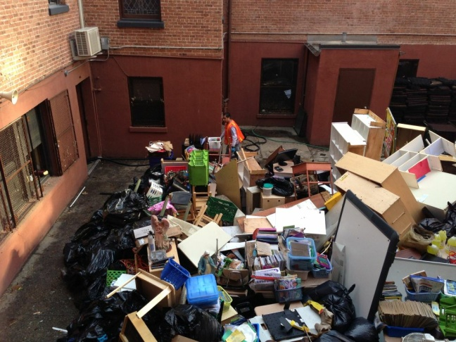 Workers at the Guardian Angel School and Church in the Chelsea neighborhood of Manhattan bring classroom debris to the courtyard from the classrooms.