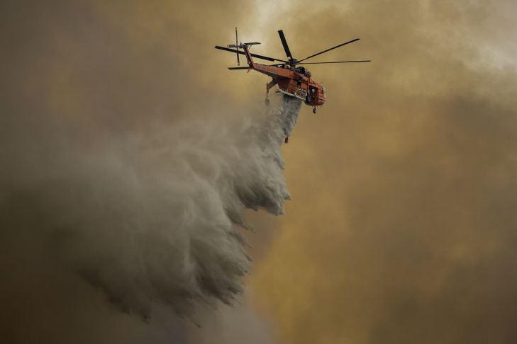 A firefighter climbs a burning hillside while fighting while the La Tuna Fire on September 2, 2017 near Burbank.