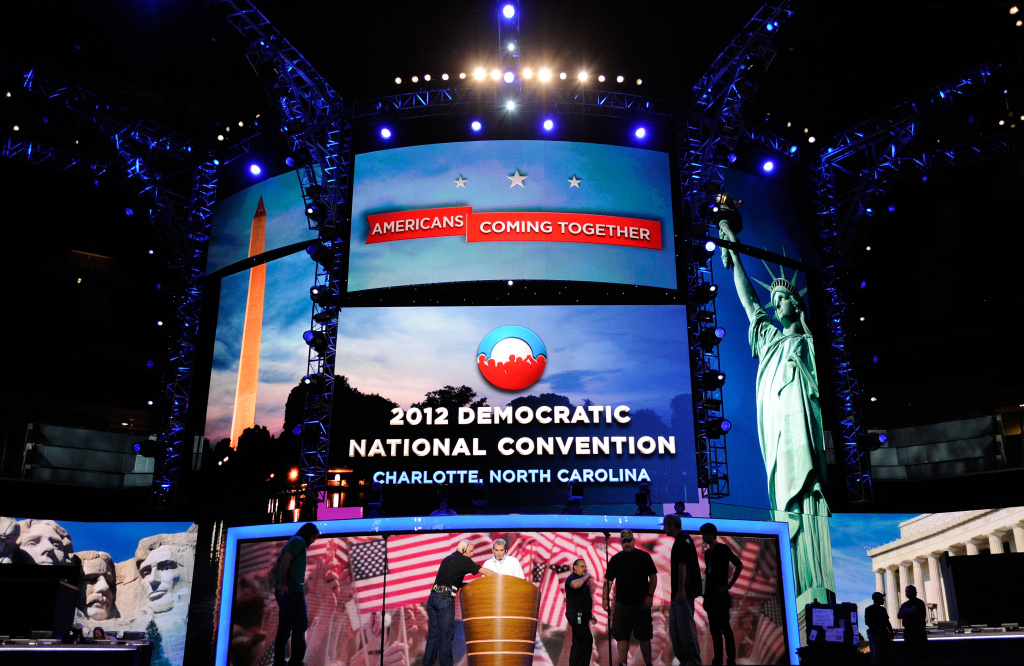 Workers stand on stage during preparations for the Democratic National Convention at Time Warner Cable Arena on September 2, 2012 in Charlotte, North Carolina. The DNC that will start on September 4 and run through September 7, will nominate U.S. President Barack Obama as the Democratic presidential candidate.