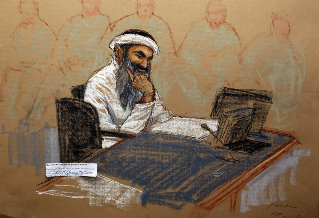 In this courtroom drawing reviewed and approved for release by a US military security official, Khalid Sheikh Mohammed sits in court on May 5, 2012 at the US Naval Base in Guantanamo Bay, Cuba.