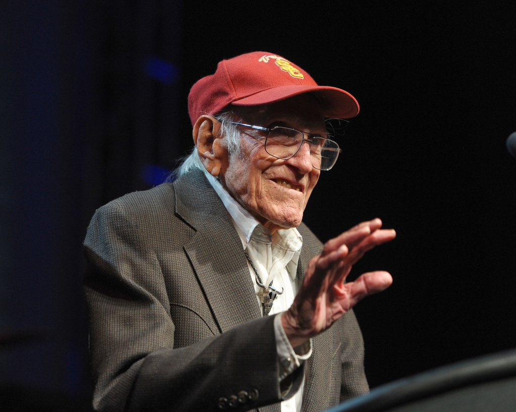 File: Louis Zamperini presents an award at the 2011 Golden Goggles at JW Marriott Los Angeles at L.A. LIVE on November 20, 2011 in Los Angeles.