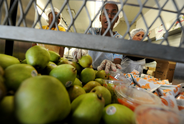 Cafeteria workers prepare lunches for school children at the Normandie Avenue Elementary School in South Central Los Angeles on December 2, 2010.