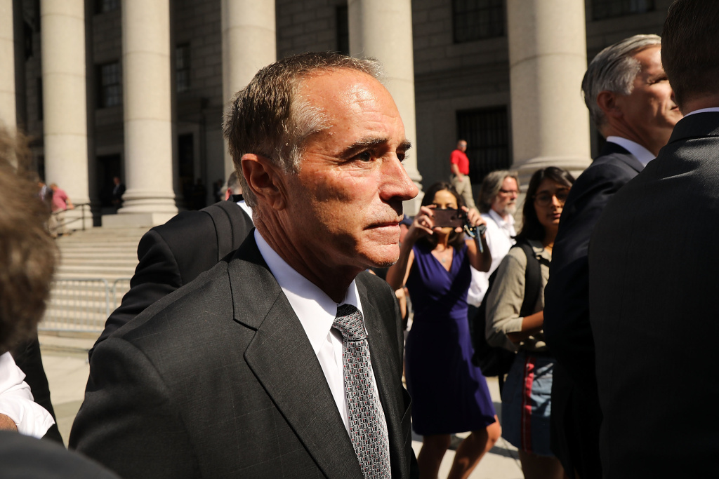 Rep. Chris Collins, R-N.Y., walks out of a New York courthouse on Aug. 8 after being charged with insider trading. Collins suspended his congressional campaign after the indictment but has decided to resume his re-election bid.