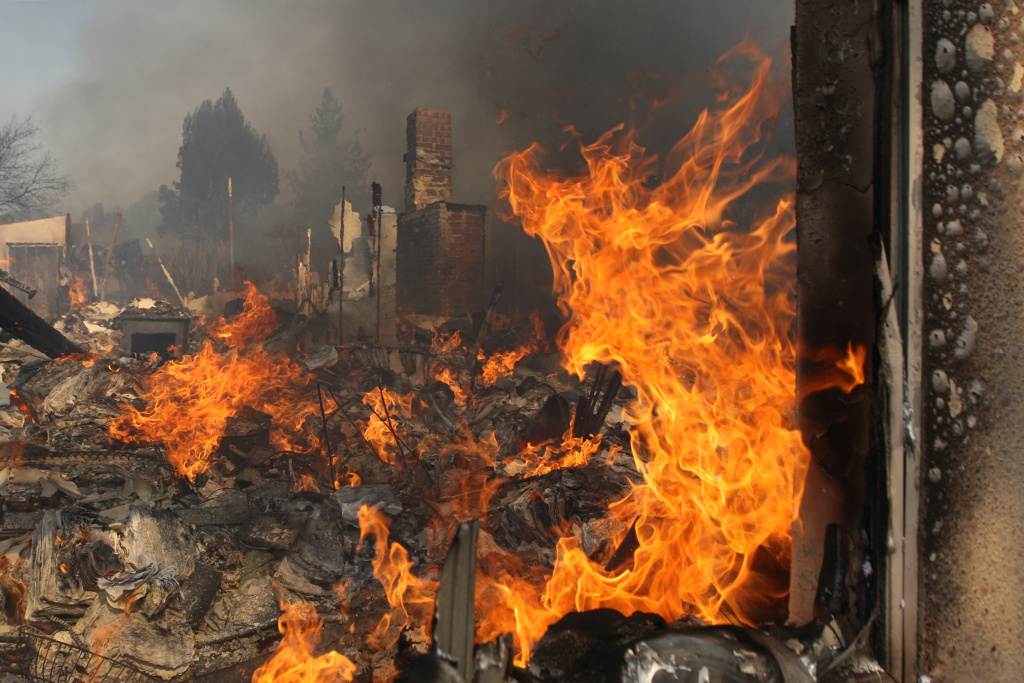 A house burns on May 15, 2014 in San Marcos, California. Fire agencies throughout the state are scrambling to prepare for what is expected to be a dangerous year of wildfires in this third year of extreme drought in California.
