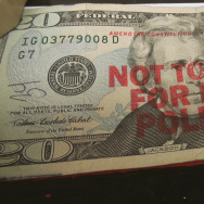 """Not to be used for bribing politicians"" stamped on $20 bill. From the HBO documentary ""Meet the Donors: Does Money Talk?"""