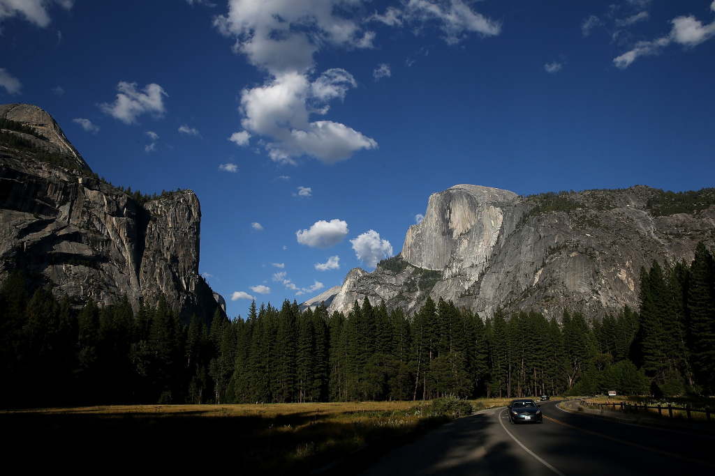 A view of Half Dome and the Yosemite Valley on August 28, 2013 in Yosemite National Park, California. The park has been hard-hit this year, first with the massive Rim Fire and then with the government shutdown, both of which affected the local tourism industry.