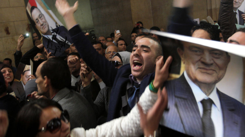 Egyptians supporters of ousted former President Hosni Mubarak celebrate an appeal granted by a court in Cairo, Egypt, Sunday.