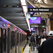 Passengers walk on the platform after exiting a train at the Universal City Metro train station on December 6, 2016 in Universal City, California.