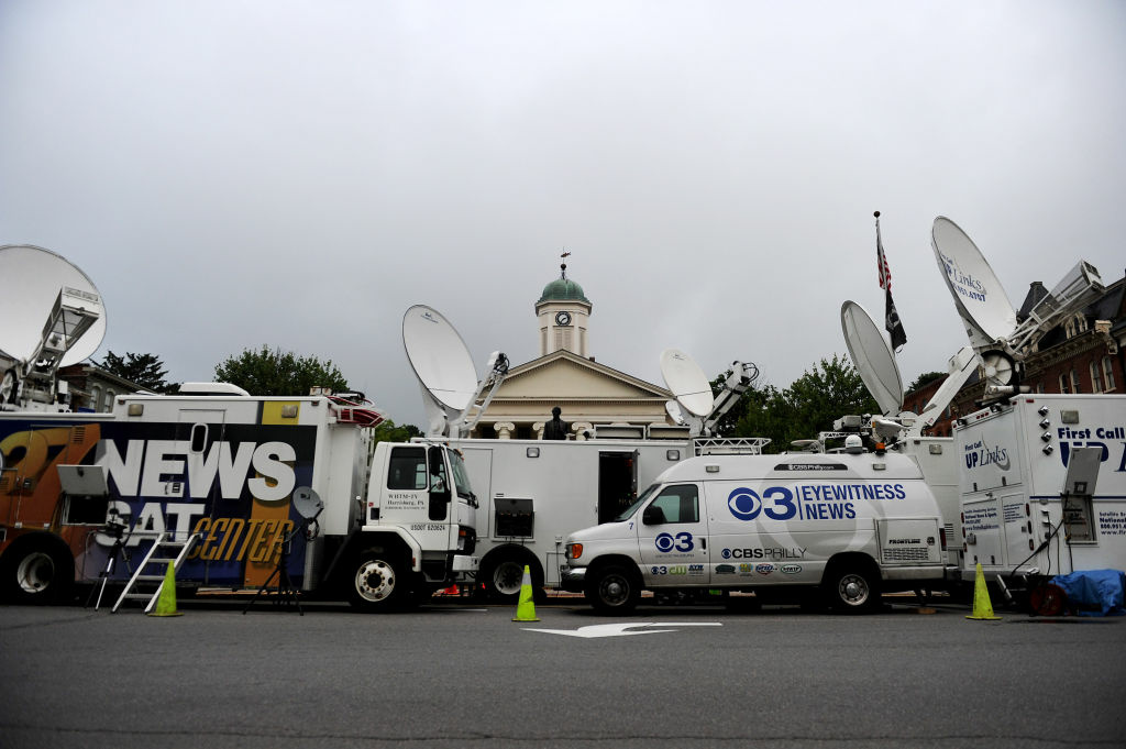 Media vans sit in front of the Centre County Courthouse today in Bellefonte, Pennsylvania as jury selection begins for Jerry Sandusky's child sex abuse trial. Local reporter Anne Danahy says that the increased media presence in Happy Valley has been hard on the community, particularly some Penn State students.